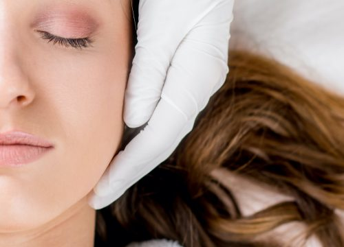 Woman about to receive a microneedling treatment