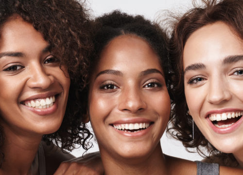 Three happy women with great skin