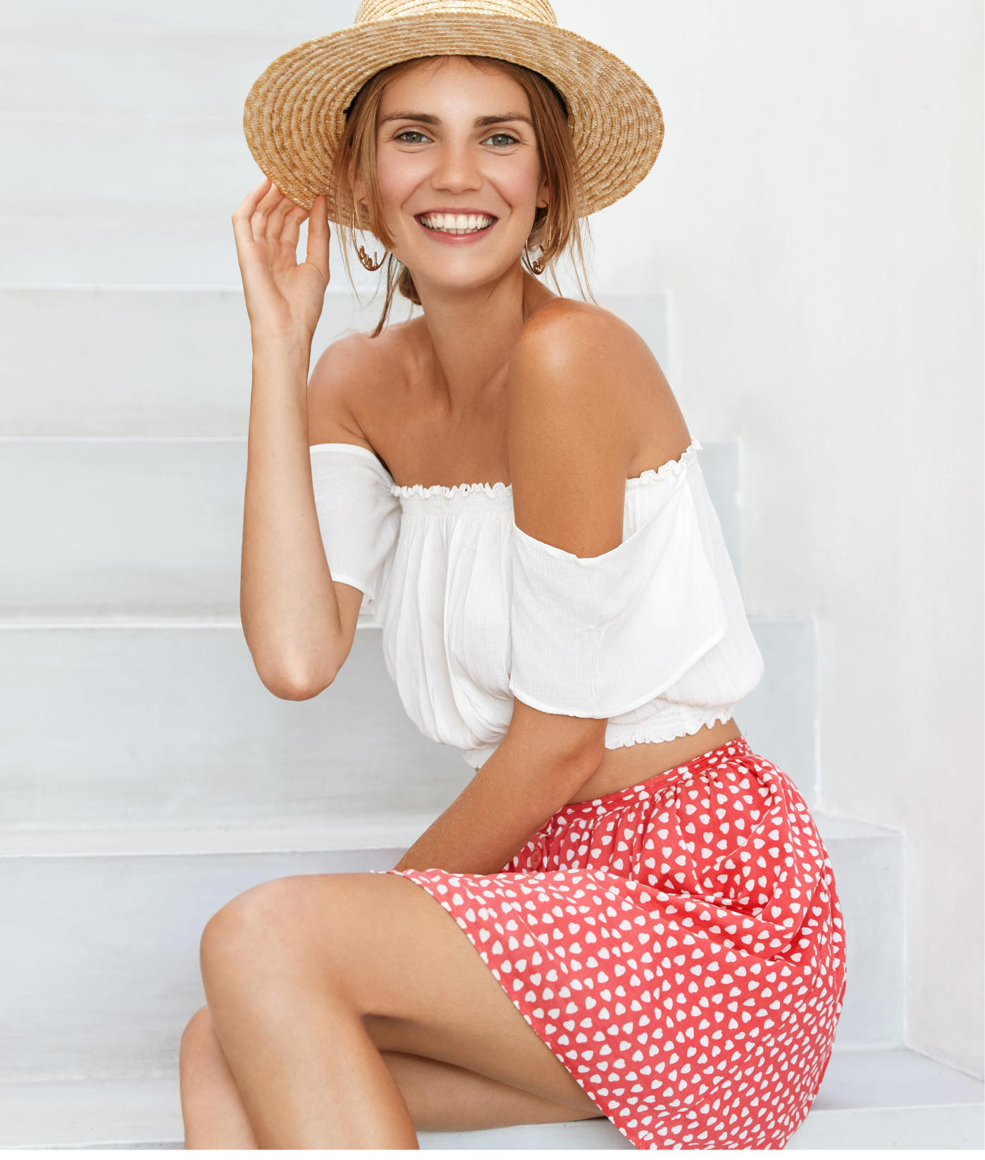 Woman wearing a white top and polka dot skirt